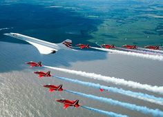Concorde and the Red Arrows in their famous formation.