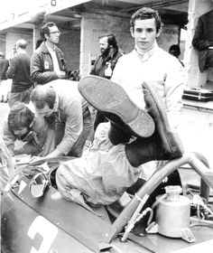 Jacky Ickx - The mechanics are obviously adjusting the pedals of the Ferrari of young Mr Ickx, 25 years old at that time. Ferrari F1, Ferrari Racing, Formula 1, Grand Prix, Gp Moto, Jochen Rindt, Automobile, Gilles Villeneuve, Racing Events