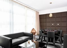 Chocolate-patterned wall panelling and sofas shaped like Toblerones feature in Dutch designer Marcel Wanders' Swiss-inspired hotel in Zurich.