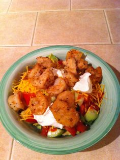 Best low carb dinner salad.... Cucumber, tomato, onion, cilantro, avocado, shrimp, chicken, sour cream, cheese, and sriracha.