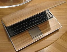 Here is an eco-friendly laptop called ASUS Ecobook. The cover of this laptop is made up of Bamboo. Another cool thing is that the plastic used in this is labeled and recyclable. All component are also lined with cardboard and no paint or spray is used.