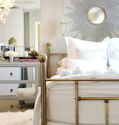 Brass bedframe and starburst mirror