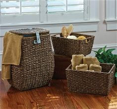 Hand Woven Hamper and Storage Baskets Suited for today's busy family, these hand woven baskets are made with natural Lampakanay and flat Rattan, woven around an iron frame for stability and durability. As beautiful as they are functional, they will become the mainstay of your daily life. The hamper features a cotton liner with Velcro snaps for easy removal and washing. Storage baskets next and feature cut-out handles. Store and tote with ease.