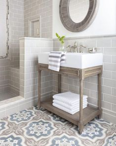 modern farmhouse master bathroom,modern farmhouse bathroom design, neutral bathroom design with tile walk in shower, subway tile, and bathroom vanity with rustic wood cabinets and round mirror and black metal sconce and cement tile floor with shiplap Modern Master Bathroom, Modern Farmhouse Bathroom, Modern Bathroom Design, Bathroom Interior Design, Small Bathroom, Bathroom Ideas, Bathroom Renovations, Bathroom Organization, Bathroom Inspiration