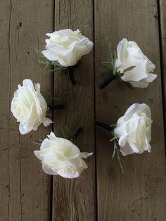 Simple white rose boutonnières
