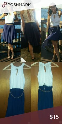 Papaya's White and Navy Blue Dress Two tone dress: top is white with lace pattern; the bottom is a chiffon navy blue flowy skirt. The skirt is asymetrical - longer in the front and back, shorter on the sifes. The back is open. A gold chain wraps around the waist. Papaya Dresses Asymmetrical