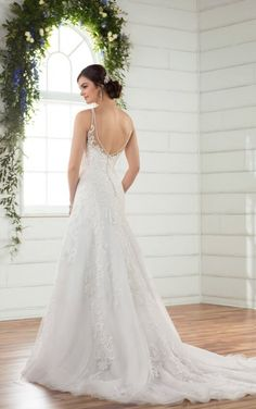 This Essense A-line gown with lace and tulle is a true classic.  With the largest plus size collection in Southwest Florida, come try on gown D2391+ available at The Perfect Dress of Sarasota.  Call us at 941.925.5888 to schedule your appointment with our bridal experts.