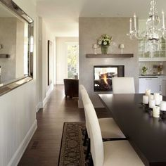 like the dark wood and white dining set with the white candles. also love the long mirror on the wall