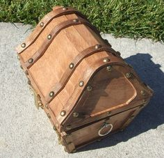 Wooden treasure chest, X-S child sized, lined with functioning padlock and key. $60.00, via Etsy.