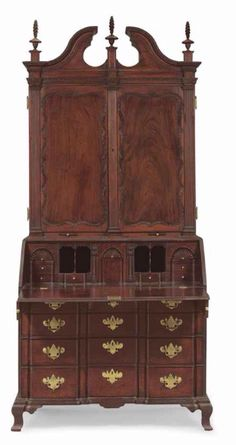 A CHIPPENDALE CARVED MAHOGANY BLOCK-FRONT DESK-AND-BOOKCASE -  BOSTON, 1760-1790 -  appears to retain its original cast brass hardware  96 in. high, 42 in. wide, 22 1/2 in. deep
