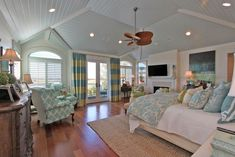 Cottage Master Bedroom with Vaulted ceiling & stone fireplace in ...