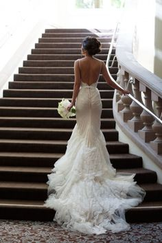 Unique backless lace wedding dress with an amazing train!