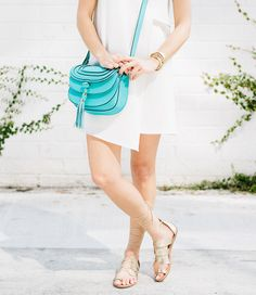 Sydne Style wears Charming Charlie turquoise cross body bag for summer trends