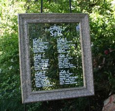 Custom mirror seating chart with monogram title.