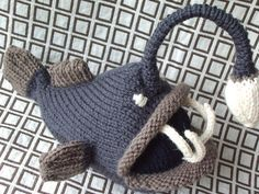 Deep Sea Angler Fish by hansigurumi, via Flickr    Technically this isn't a hat but I'm sure there is a way to make it into one.