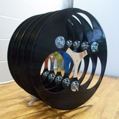 20 DIY: Unique and Interesting Vinyl Record Projects - Wine Rack - Stack your favorite wines in this wine rack. Records Diy, Old Vinyl Records, Vinyl Record Art, Vinyl Art, Vinyl Record Projects, Built In Wine Rack, Deco Nature, Vinyl Crafts, Music Crafts