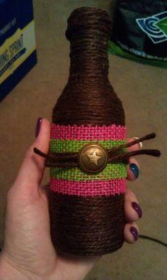 Mini wine bottle wrapped in jute pink & green burlap.  Pink, green, & brown wedding