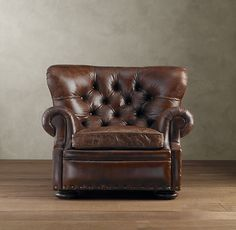 Churchill chair from Restoration Hardware.  The style is a traditional, but the shape could be nice in the space, as it adds more definition than a boxy, modern style would.