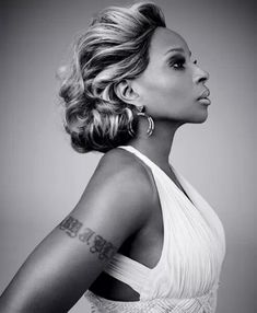 "Mary J. Blige... Her album ""My Life"" took me through real hard period in my life.  Love her ever since."