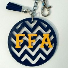 FFA colors show stock keychains. So excited about this line if keychains. Your FFA fan will love them. Ffa Creed, Acrylic Keychains, Showing Livestock, Gifts For Office, Vinyl Crafts, Agriculture, Environmental Education, Food Safety, Biotechnology