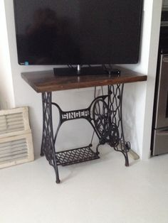 Antique sewing machine base transformed into a beautiful TV stand.