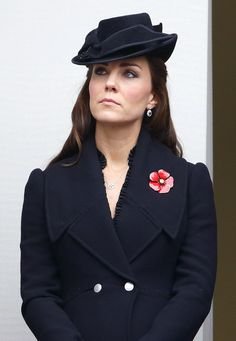 Kate's latest look came by way of Alexander McQueen — a black coat and matching hat that conjured images of a rose — which coordinated well with the poppy she wore to the annual Remembrance Sunday Service.