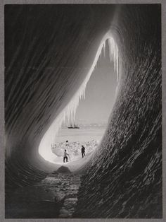 A grotto in an iceberg, photographed during the British Antarctic Expedition of 1911-1913. Photographer Herbert Ponting snapped this photograph in January 1911.