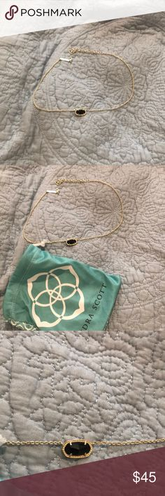 Kendra Scott Necklace It's gold with black in the center!It is in great condition.No coloring fading and it's not broken. Kendra Scott Jewelry Necklaces