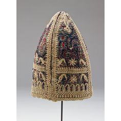 Dervish Headdress Object Use: Clothing, Headwear Object Class: Fiber Media Support: Cotton, silk Keywords: Dimensions: 11 in. x 6 1/2 in. x 8 1/2 in. (27.94 cm x 16.51 cm x 21.59 cm) Creation Date: Century: 20th Century Period: Culture: Creation Place: Middle East, Iran