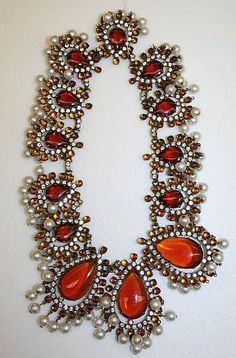 Necklace by Kenneth Jay Lane, 1968: Jewelry of the 60s shift from the matching sets of the 50s to a chunky, in-your-face design that corresponded with the simple new silhouettes.