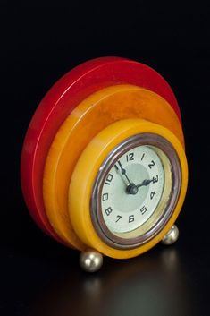 "Rare geometric New Haven Clock Tri-Color Catalin Bakelite disc design. Stunning marbleized red, orchid and yellow small seldom seen Art Deco Catalin Bakelite New Haven desk clock from the 1930's. Measures approximately: 4"" by 4"" by 1.25"" deep. Clock ticks when wound, do not know if it keeps time. If you wish to use it daily, it is recommended you have a qualified professional service it, as it may need lubrication + calibration."