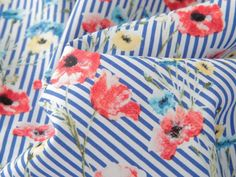 Happy FriYay! We've got a new version of our sell out stripe and floral stretch cotton poplin. Last time this went straight out of the door so I am really pleased we got this new poppies design. #stretchpoplin #poppies #friyay #summersewing