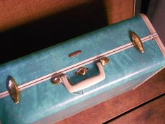 Vintage SAMSONITE SUITCASE LUGGAGE, minty marbled green, lovely interior, hanging rod, gorgeous for spring. $68.00, via Etsy.
