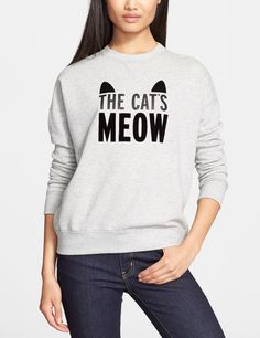 The glittery, velvety statement on this Kate Spade sweatshirt is totally purr-fect.