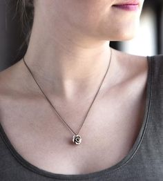 Cast from a hand-sculpted clay model, this bronze necklace is a nod to the City of Roses—Portland, that is.