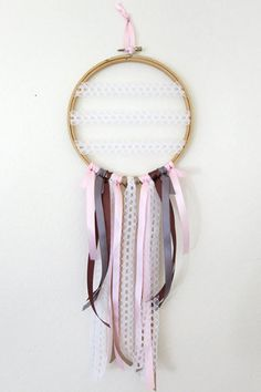 Who knew an embroidery hoop could be so cute? This design by Simple Devotion uses lace, ribbon, and a trusty old embroidery hoop to create the perfect alternative to the traditional bridal bouquet.