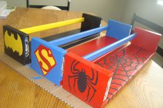 Ikea Bekvam shelves painted for each Super Hero.  for his books