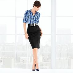 A pop of animal print with a waist-cinching belt? Sign us up for this flattering look! #whbm #fashion #work #style