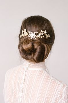 Bridal chignon accented by 'Adele' Gold Crystal Hair Comb by BrideLaBoheme | Photography by Lana Ivanova