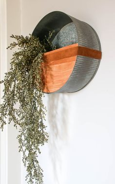 Are you in love with faux plants? Then you'll love this post! We give you a simple step by step tutorial that will inspire you to make your own! #DIY #wallplanter #farmhousedecor Galvanized Wall Planter, Wall Decor Crafts, Cottage Style Decor, Floral Foam, Recycled Leather, Faux Plants, Baskets On Wall, Floral Centerpieces, Boho Decor