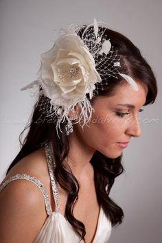 Bridal Birdcage Veil Wedge with Silk Flower, Fly-Away Netting and Rivoli Crystal Rhinestone Center. $98.95, via Etsy.