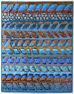 Gorgeous reverse appliqué quilt