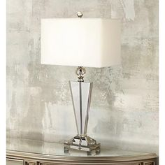 Strong, bold lines and a spectrum crystal construction create this contemporary table lamp's modish appeal.