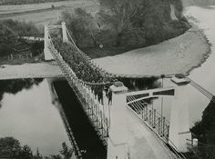 Collection: Upper Hutt Public Library | Read the full record details for Photo: Maoribank suspension bridge; troops crossing. [P3-151-752]