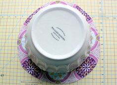 """DIY bowl covers1 Fat Quarter (should be enough for a large bowl)  1 package double fold bias tape (or you can make your own)  Thin Elastic - 1/8"""" or 1/4"""" (the amount depends on the size of your bowl)  Safety Pin  Sewing Machine  Scissors"""