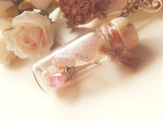 Items similar to Memory Lane. Paris. Custom unique bottle filled with pearls, swavorski pink heart crystal, eiffel tower paris charm, french ribbon necklace on Etsy