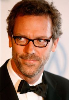 Hugh Laurie. Somehow more adorkable than ever w/glasses.  I loved when House had to read something and put on the specs...