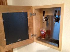 You can hide anything in our Concealed Cabinets. This customer customized theirs to hold BEER TAPS behind their home bar. Awesome!