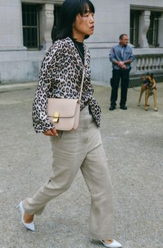 Miyuki Uesugi with a Céline bag spotted on the street at Paris Fashion Week. Photographed by Phil Oh.