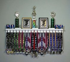 Premier Medal Hanger Award Display and Trophy Shelf The Premier Award Display Rack for all your hard-earned Award Medals, Trophies, and Plaques! Trophy Shelf, Trophy Display, Award Display, Display Medals, Race Medal Displays, Medal Display Case, Hanging Medals, Diploma Display, Boy Room